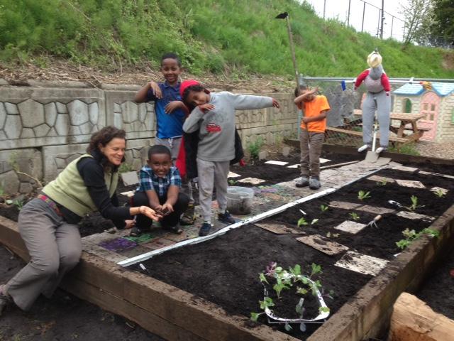 Jackie Cramer with kids in their garden in Seattle
